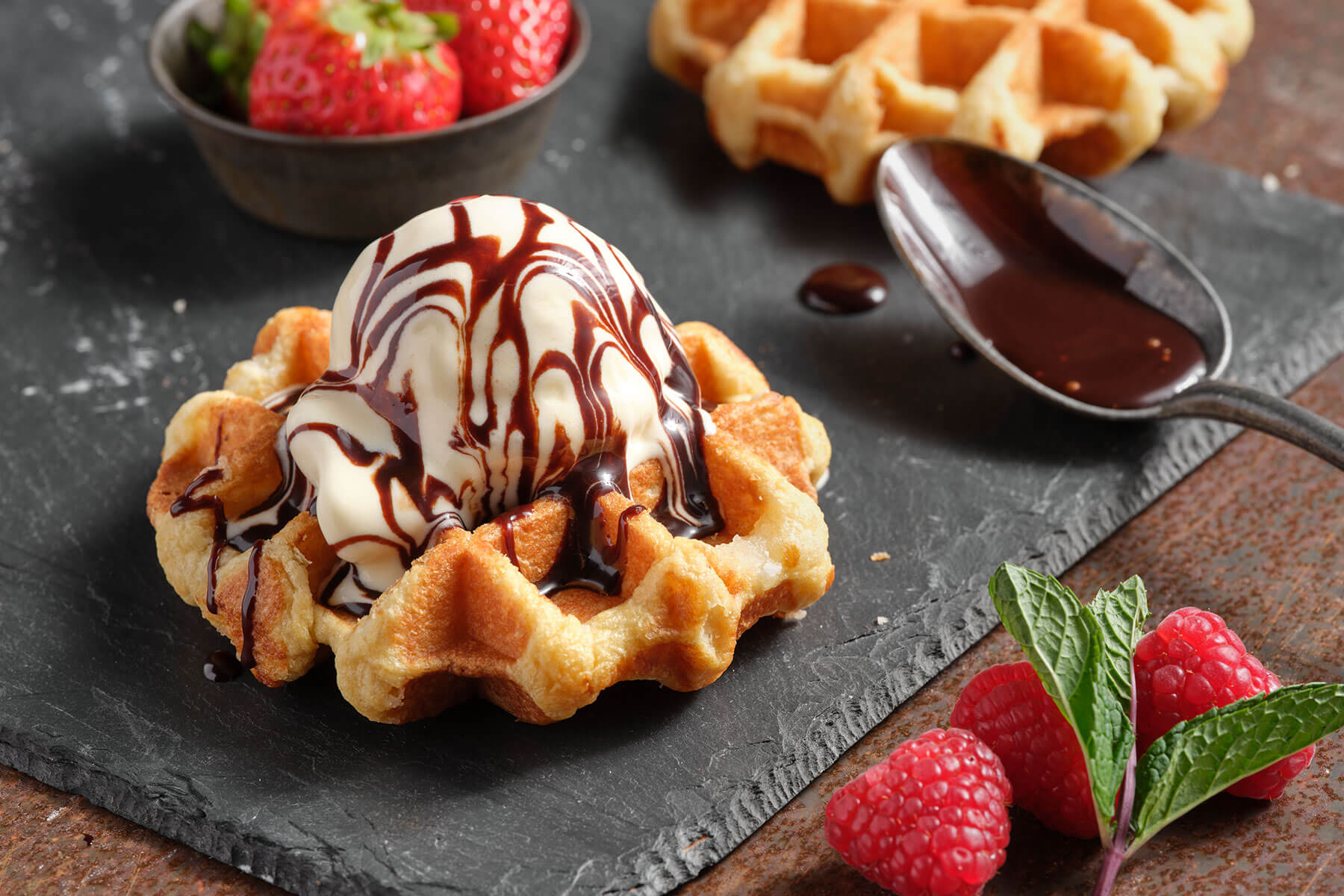 scoop of ice cream on top of a waffle
