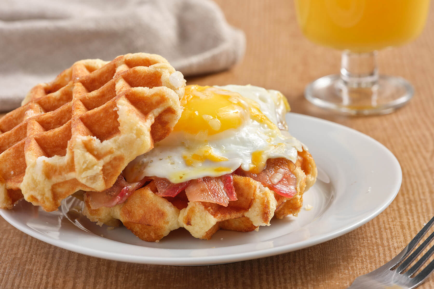 fried egg on top of a waffle
